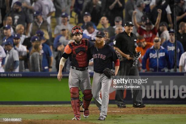 Catcher Blake Swihart and pitcher Craig Kimbrel of the Boston Red Sox congratulate one another after defeating the Los Angeles Dodgers 96 in Game...