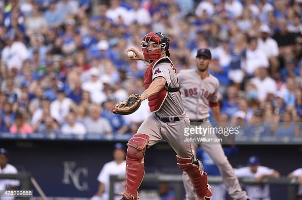 Catcher Blake Swihart of the Boston Red Sox chases the runner caught in a rundown back to third base in the game against the Kansas City Royals on...