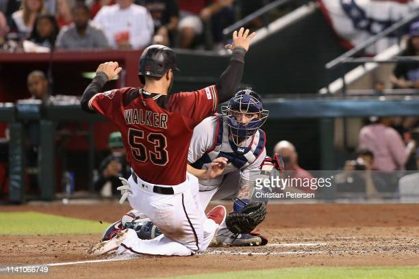 Catcher Blake Swihart of the Boston Red Sox tags out the sliding Christian Walker of the Arizona Diamondbacks during the fifth inning of the MLB game...