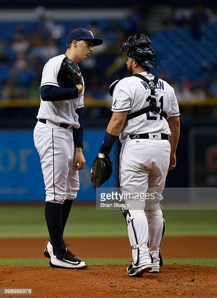 Catcher Bobby Wilson of the Tampa Bay Rays comes out to the mound to have conversation with pitcher Blake Snell after Snell walked Josh Donaldson of...