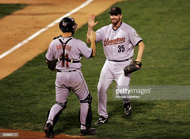 Catcher Brad Ausmus and relief pitcher Dan Wheeler of the Houston Astros celebrate their 51 win over the St Louis Cardinals in Game Six of the...