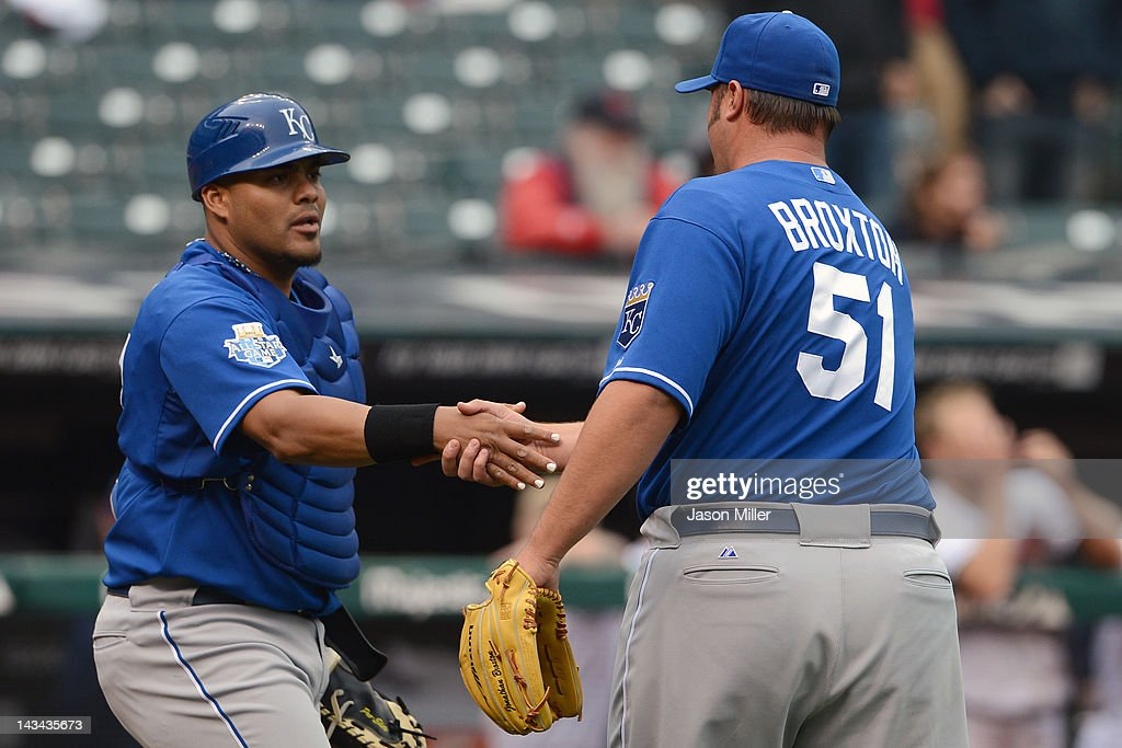 Catcher Brayan Pena #27 shakes hands with closing pitcher Jonathan Broxton #51 of the Kansas City Royals after they defeated the Cleveland Indians 4-2 at Progressive Field on April 26, 2012 in Cleveland, Ohio. The Royals defeated the Indians 4-2.
