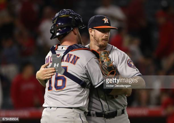 Catcher Brian McCann and pitcher Chris Devenski of the Houston Astros celebrate after their 76 10inning win against Los Angeles Angels of Anaheim in...