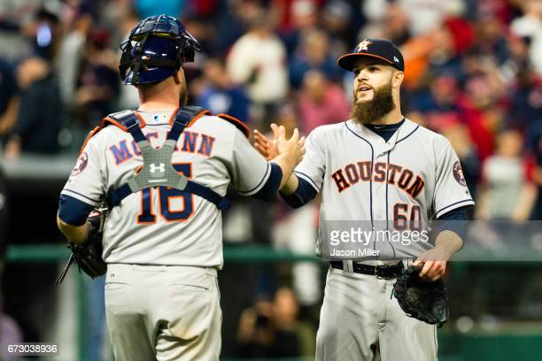 Catcher Brian McCann celebrates with starting pitcher Dallas Keuchel of the Houston Astros after Kuechel pitched a complete game to defeat the...