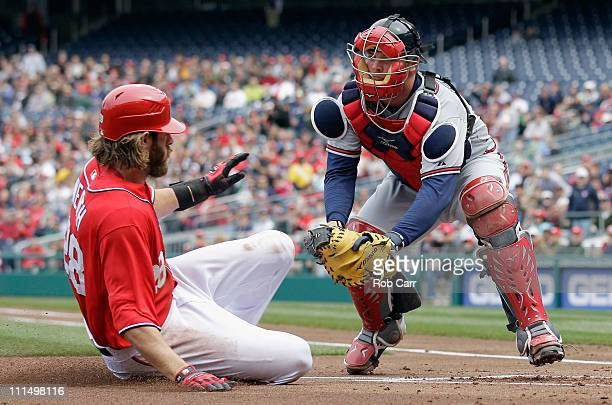 Catcher Brian McCann of the Atlanta Braves tags out Jayson Werth of the Washington Nationals at home plate during the at Nationals Park on April 3...