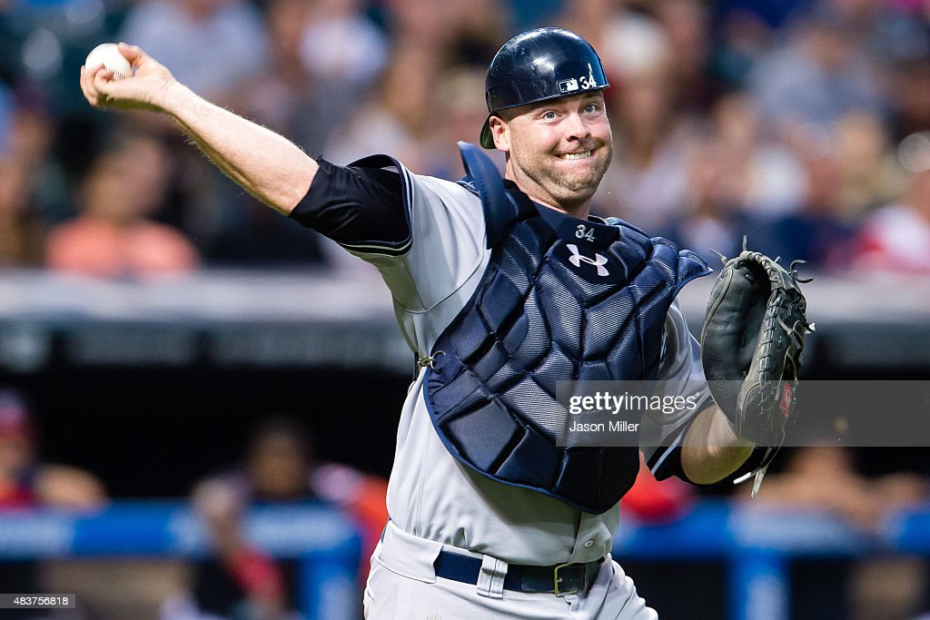 Catcher Brian McCann #34 of the New York Yankees throws out Jose Ramirez of the Cleveland Indians at first during the fifth inning at Progressive Field on August 12, 2015 in Cleveland, Ohio.