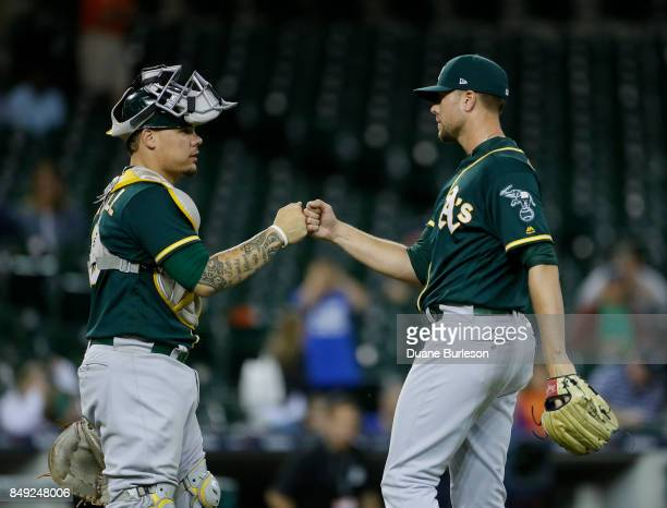 Catcher Bruce Maxwell of the Oakland Athletics celebrates with pitcher Blake Treinen of the Oakland Athletics after a 83 win over the Detroit Tigers...