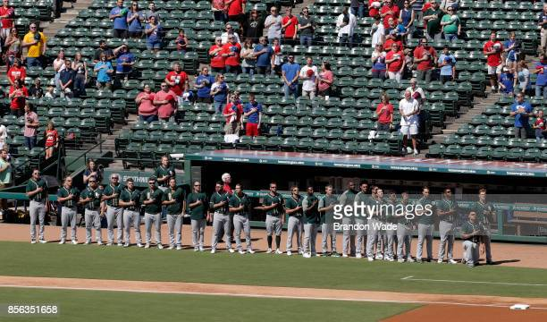 Catcher Bruce Maxwell of the Oakland Athletics kneels during the playing of the National Anthem before a baseball game against the Texas Rangers at...