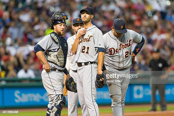Catcher Bryan Holaday shortstop Eugenio Suarez starting pitcher Rick Porcello and first baseman Miguel Cabrera of the Detroit Tigers gather at the...
