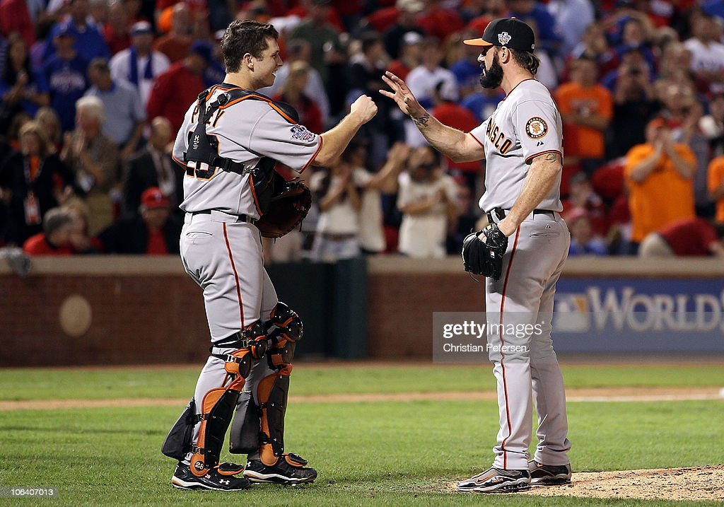 Catcher Buster Posey #28 and closing pitcher Brian WIlson #38 of the San Francisco Giants celebrate after their 4-0 win against the Texas Rangers in Game Four of the 2010 MLB World Series at Rangers Ballpark in Arlington on October 31, 2010 in Arlington, Texas.