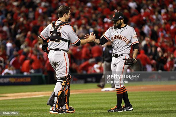 Catcher Buster Posey and Sergio Romo of the San Francisco Giants celebrate the Giants 50 victory in Game Five of the National League Championship...