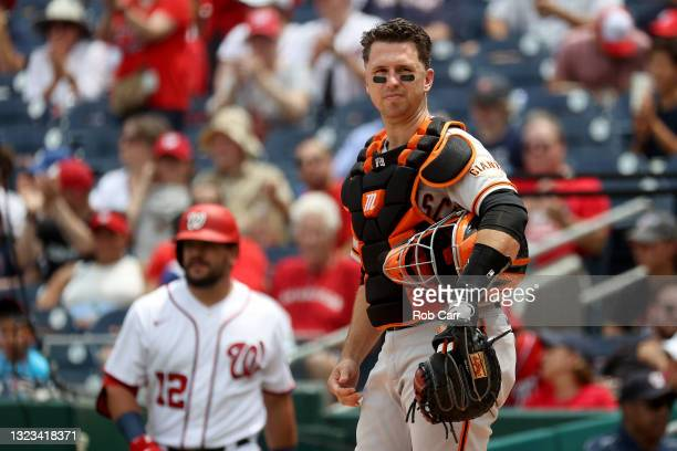 Catcher Buster Posey of the San Francisco Giants looks on against the Washington Nationals at Nationals Park on June 13, 2021 in Washington, DC.