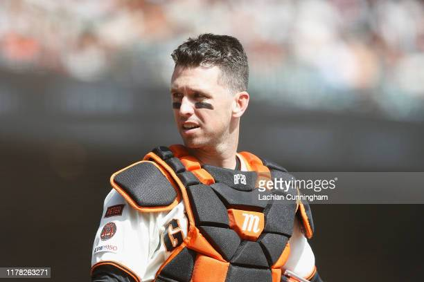 Catcher Buster Posey of the San Francisco Giants looks on from home plate during the game against the Los Angeles Dodgers at Oracle Park on September...