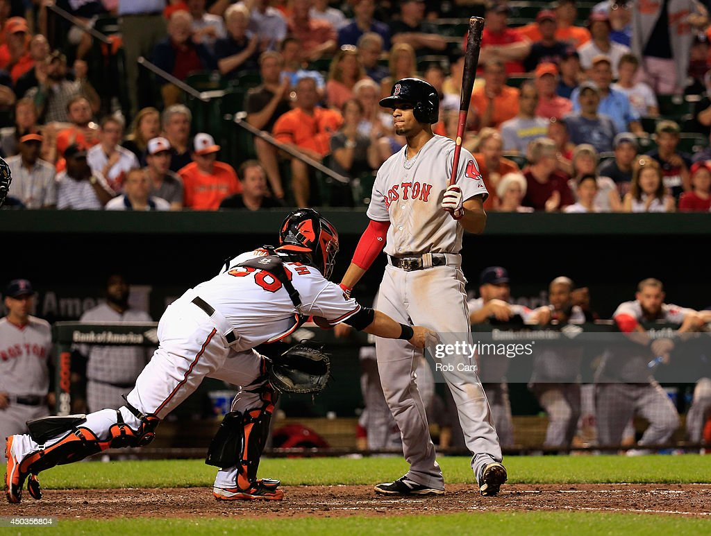 Catcher Caleb Joseph #36 of the Baltimore Orioles tags out Xander Bogaerts #2 of the Boston Red Sox after striking out for the third out of the eighth inning during the Orioles s4-0 win at Oriole Park at Camden Yards on June 9, 2014 in Baltimore, Maryland.