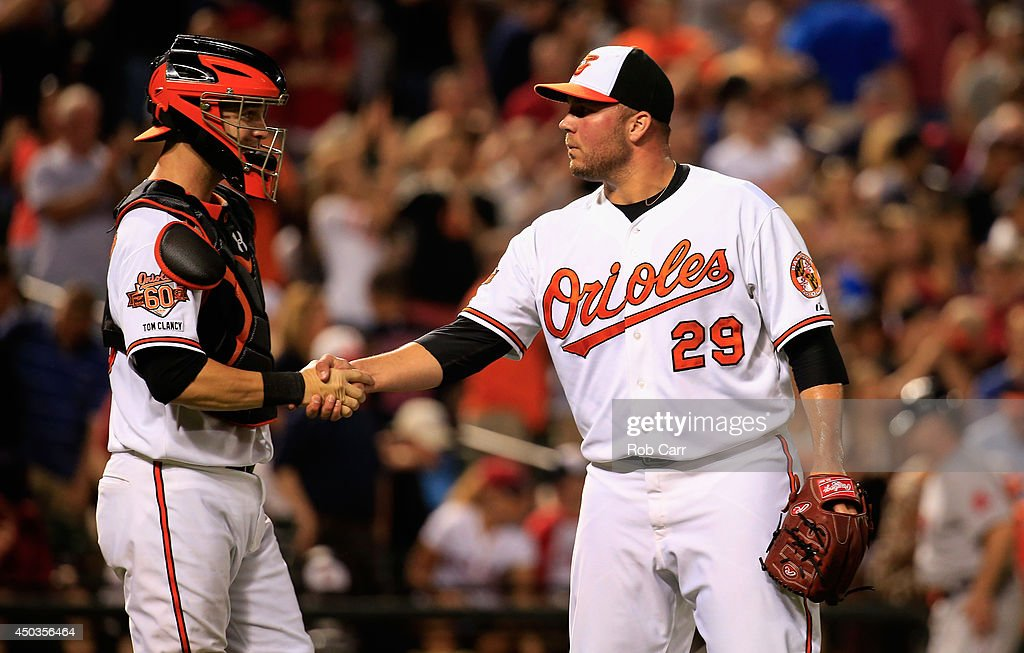 Catcher Caleb Joseph #36 shakes hands with closer Tommy Hunter #29 of the Baltimore Orioles following the Orioles 4-0 win at Oriole Park at Camden Yards on June 9, 2014 in Baltimore, Maryland.