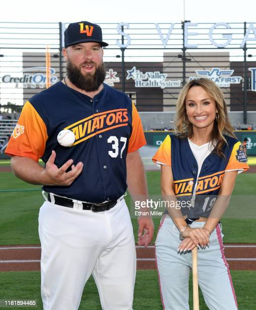 Catcher Cameron Rupp of the Las Vegas Aviators poses with chef Giada De Laurentiis during her celebrity chef appearance at Las Vegas Ballpark on July...