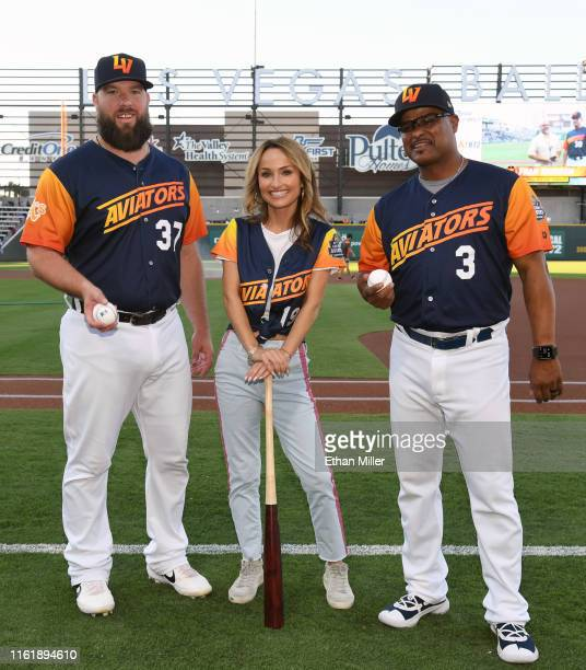Catcher Cameron Rupp of the Las Vegas Aviators chef Giada De Laurentiis and hitting coach Eric Martins of the Aviators pose on the field during her...