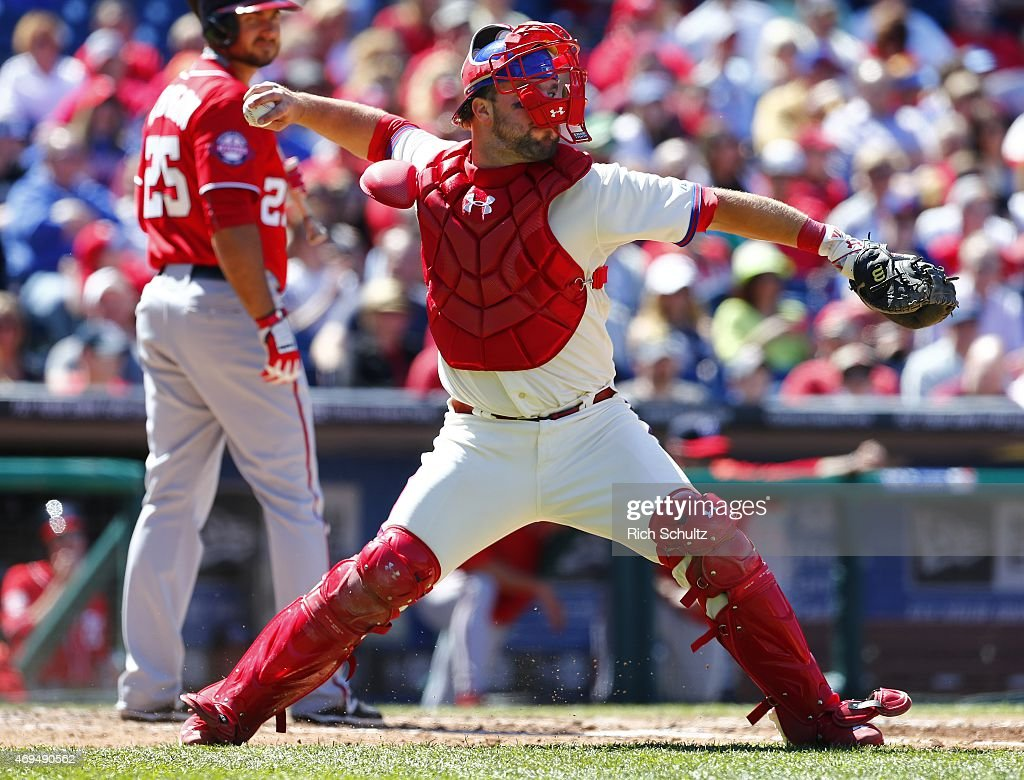 Catcher Cameron Rupp #29 of the Philadelphia Phillies attempts to throw out Ryan Zimmerman #11 of the Washington Nationals on a passed ball during the third inning of a game at Citizens Bank Park on April 12, 2015 in Philadelphia, Pennsylvania.