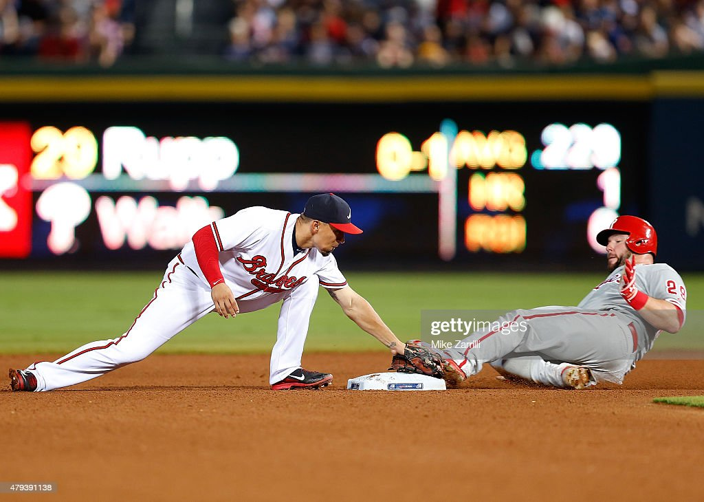 Catcher Cameron Rupp #29 of the Philadelphia Phillies is tagged out at second base by second baseman Jace Peterson #8 of the Atlanta Braves in the seventh inning during the game at Turner Field on July 3, 2015 in Atlanta, Georgia. Rupp was originally called safe by the call was overturned by official review.