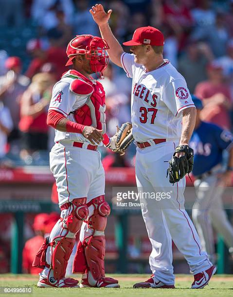 Catcher Carlos Perez and relief pitcher Andrew Bailey of the Los Angeles Angels of Anaheim celebrate after defeating the Texas Rangers 32 in the game...