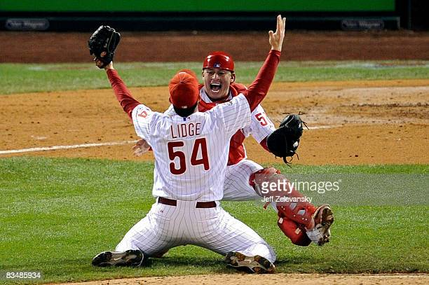 Catcher Carlos Ruiz and Brad Lidge of the Philadelphia Phillies celebrate after recording the final out of their 43 win to win the World Series...