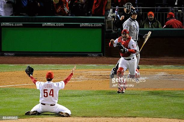 Catcher Carlos Ruiz and closing pitcher Brad Lidge of the Philadelphia Phillies celebrate after recording the final out by striking out Eric Hinske...