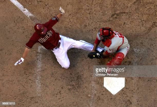 Catcher Carlos Ruiz of the Philadelphia Phillies tags out the sliding Stephen Drew of the Arizona Diamondbacks at home plate during the eighth inning...