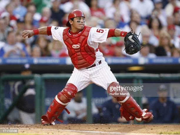 Catcher Carlos Ruiz of the Philadelphia Phillies throws to second base during a game against the Washington Nationals at Citizens Bank Park September...
