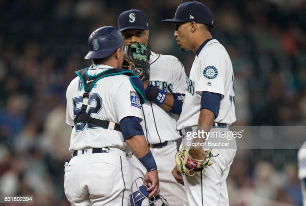 Catcher Carlos Ruiz of the Seattle Mariners second baseman Robinson Cano center of the Seattle Mariners and relief pitcher Edwin Diaz of the Seattle...