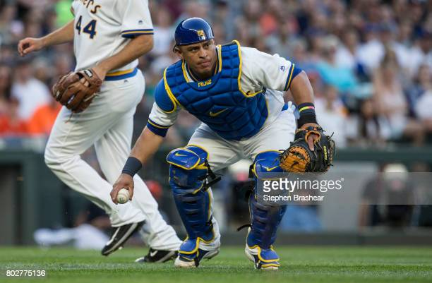 Catcher Carlos Ruiz of the Seattle Mariners throws to first base after fielding a ground ball during a game against the Houston Astros at Safeco...