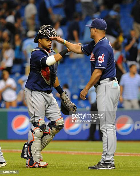 Catcher Carlos Santana and manager Manny Acta of the Cleveland Indians celebrate a 3 2 victory against the Tampa Bay Rays July 16 2012 at Tropicana...