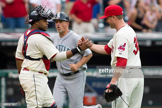 Catcher Carlos Santana celebrates with relief pitcher Joe Smith of the Cleveland Indians after the Indians defeated the Seattle Mariners at...