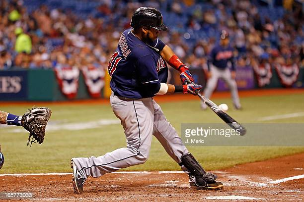 Catcher Carlos Santana of the Cleveland Indians breaks his bat on a pitch against the Tampa Bay Rays during the game at Tropicana Field on April 5...