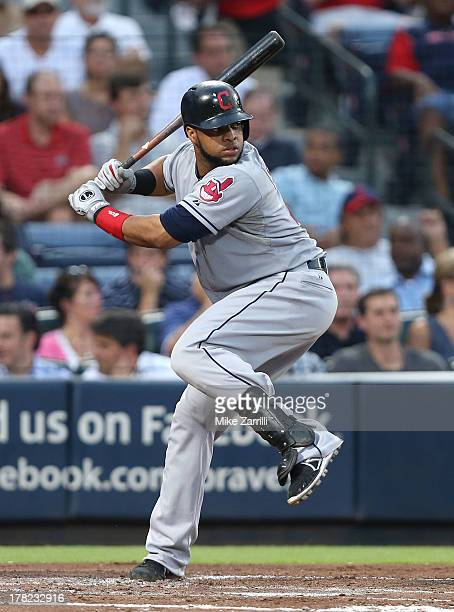 Catcher Carlos Santana of the Cleveland Indians gets set for a pitch during the game against the Atlanta Braves at Turner Field on August 27 2013 in...