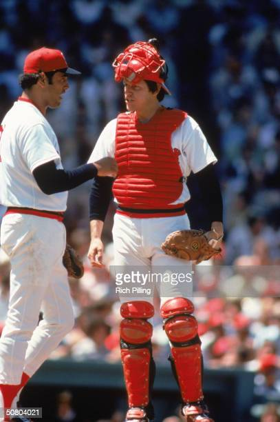 Catcher Carlton Fisk and pitcher Mike Torrez of the Boston Red Sox talk on the mound during a 1978 season game at Fenway Park in Boston Massachusetts