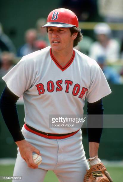 Catcher Carlton Fisk of the Boston Red Sox looks on prior to the start of a Major League Baseball game circa 1976 Fisk played for the Red Sox from...