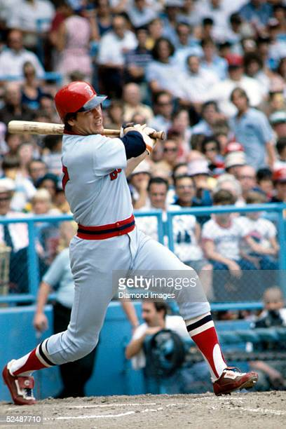 Catcher Carlton Fisk of the Boston Red Sox makes a hit during a 1978 season game against the Cleveland Indians at Municipal Stadium in Cleveland Ohio