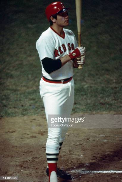Catcher Carlton Fisk of the Boston Red Sox surveys the defense before hitting during the World Series against the Cincinnati Reds at Fenway Park on...