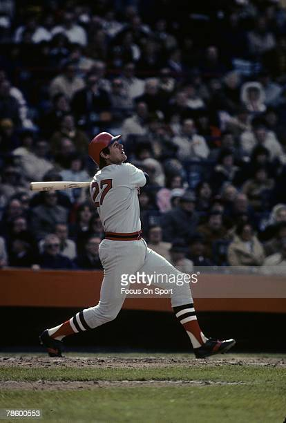 Catcher Carlton Fisk of the Boston Red Sox swings and watches the flight of his ball against the Baltimore Orioles during a MLB baseball game circa...