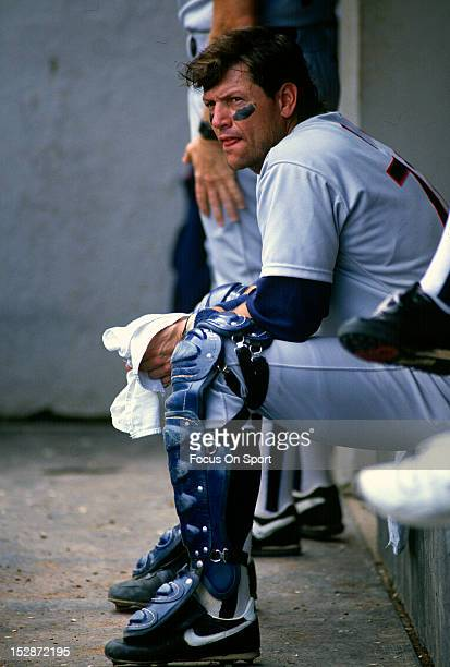 Catcher Carlton Fisk of the Chicago White Sox looks on from the dugout during an MLB baseball game circa 1987 Fisk Played for the White Sox from...