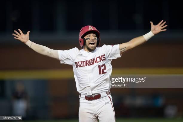 Catcher Casey Opitz of the Arkansas Razorbacks celebrates while running bases against the Nebraska Cornhuskers at the NCAA Fayetteville Regional at...