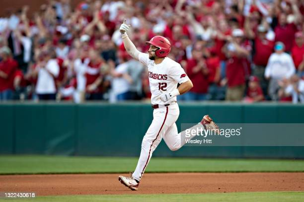 Catcher Casey Opitz of the Arkansas Razorbacks celebrates while rounding the bases after hitting a home run during a game against the Nebraska...