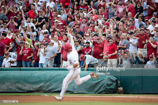 Catcher Casey Opitz of the Arkansas Razorbacks signals to the fans after hitting a home run against the Nebraska Cornhuskers at the NCAA Fayetteville...