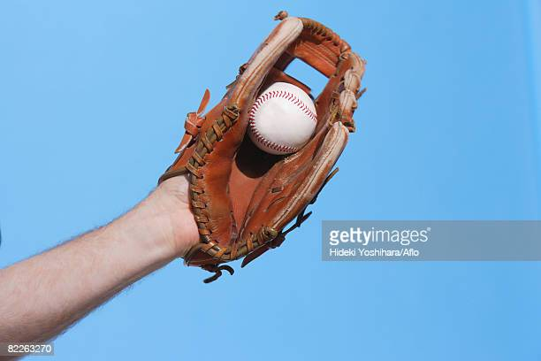 catcher catching a baseball - baseball glove stock pictures, royalty-free photos & images