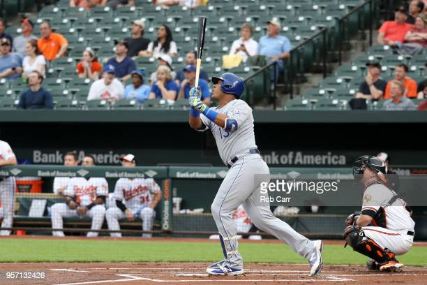 Catcher Chance Sisco of the Baltimore Orioles looks on as Salvador Perez of the Kansas City Royals follows his first inning grand slam at Oriole Park...