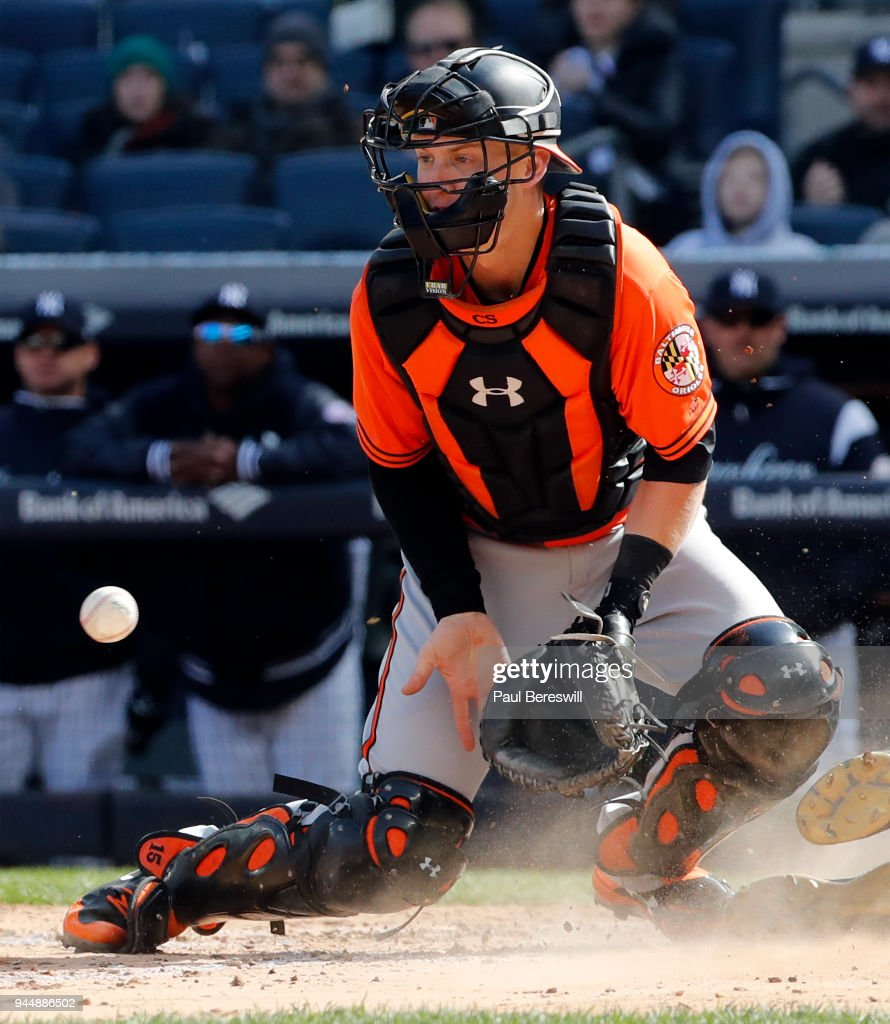 Catcher Chance Sisco #15 of the Baltimore Orioles plays the throw in from the outfield in an MLB baseball game against the New York Yankees at Yankee Stadium on April 7, 2018 in New York, NY. Yankees won 8-3.