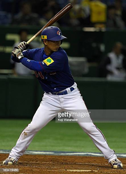 Catcher ChihKang Kao#34 of Chinese Taipei at bat during the World Baseball Classic Second Round Pool 1 game between Chinese Taipei and Cuba at Tokyo...