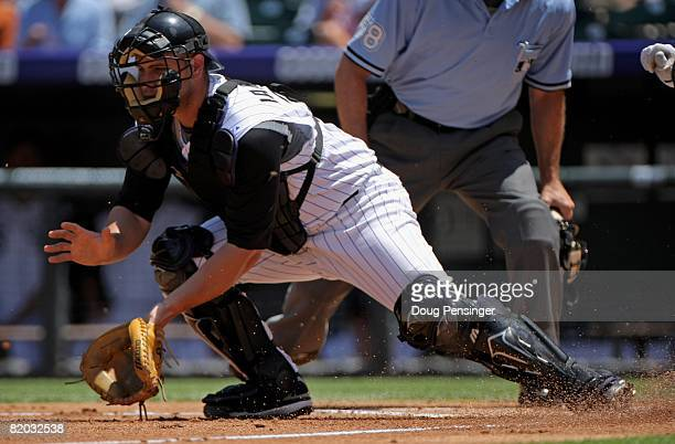 Catcher Chris Iannetta of the Colorado Rockies takes a throw at the plate against the Pittsburgh Pirates at Coors Field on July 20 2008 in Denver...