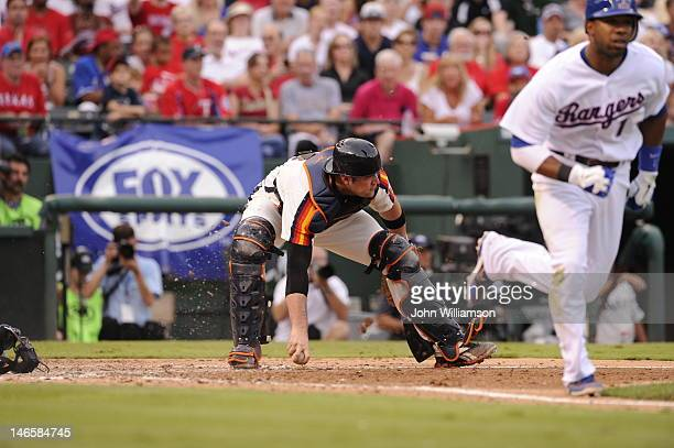 Catcher Chris Snyder of the Houston Astros fields his position as he picks up a sacrifice bunt by Elvis Andrus of the Texas Rangers in the game...