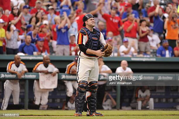 Catcher Chris Snyder of the Houston Astros stands on the field after the play is over and looks up at the scoreboard during the game against the...